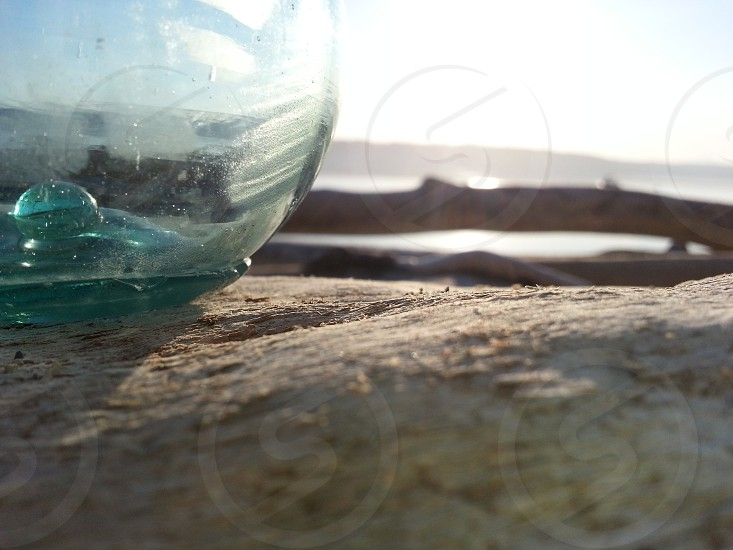 Glass float on driftwood photo