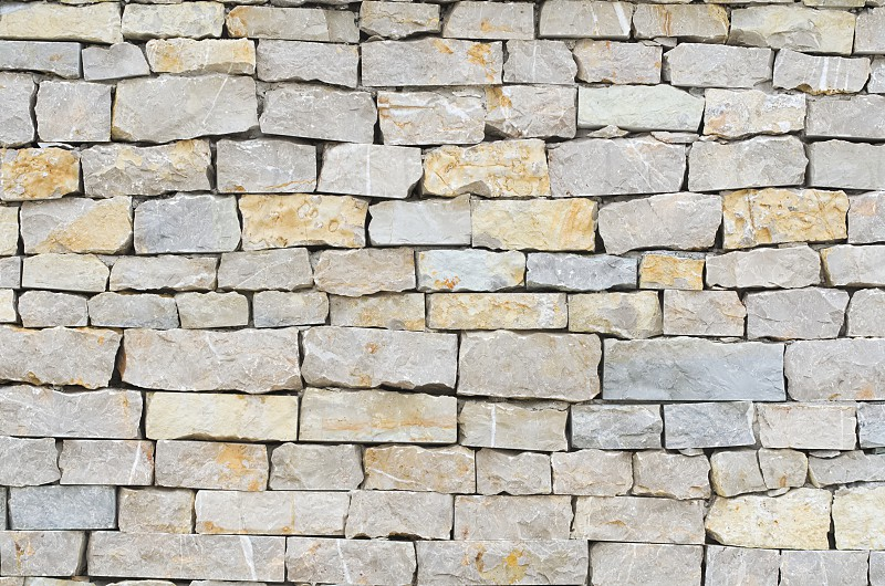 Gray and Brown Stone Wall Closeup Background photo