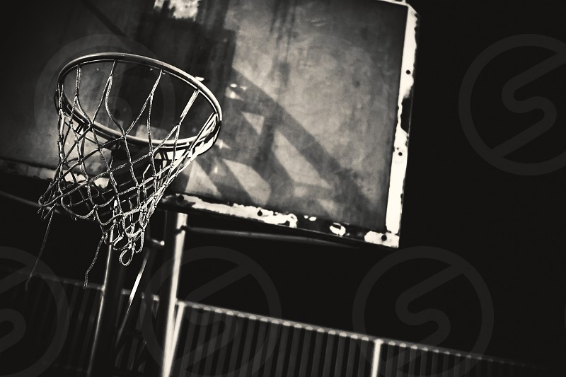 Closeup view of basketball hoop by night.  photo