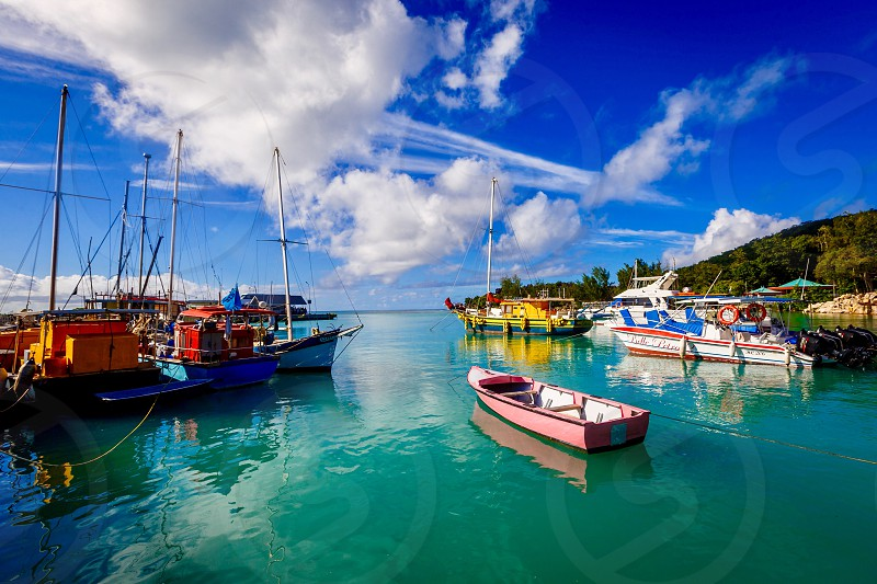 Boat ocean colored Seychelles blue green water red tourism  photo