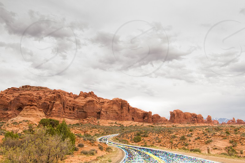 A glowing road through the red rocks and desert photo
