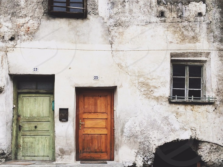 Two front doors of rustic buildings in a small town in Northern Italy. photo