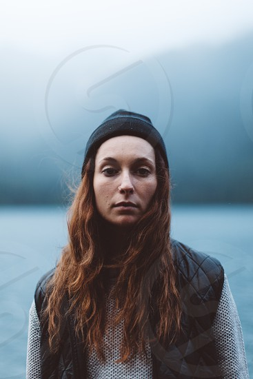 woman wearing black knit cap with brown long hair in shallow focus photo