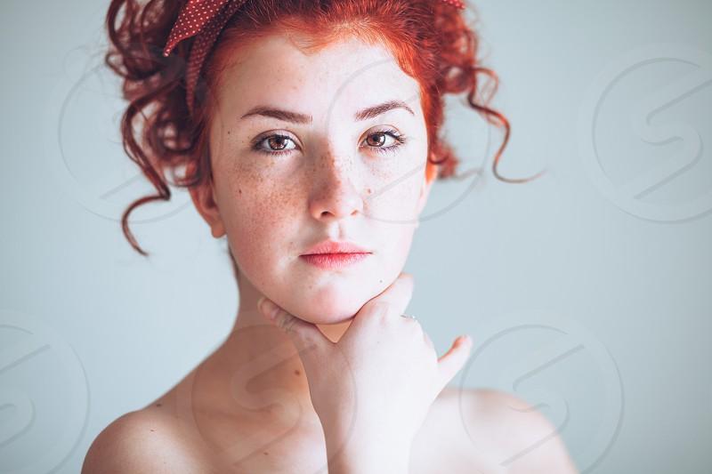 Beautiful young redhead woman photo