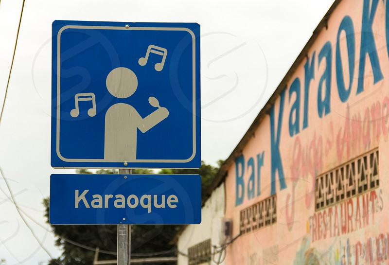 A road sign in Puerto Lopez Ecuador warning that karaoke music is nearby. photo