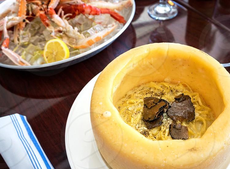 yellow round dessert food on white ceramic plate photo