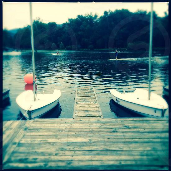 Row boats in lake photo