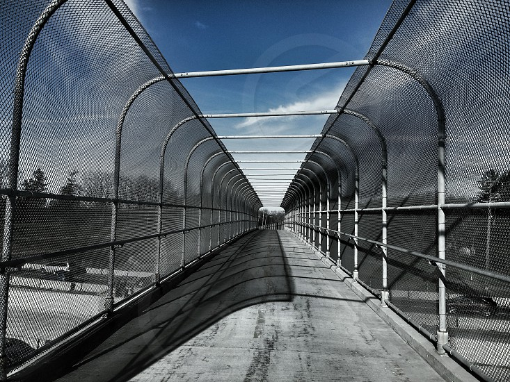 gray and black overpass under blue calm sky photo