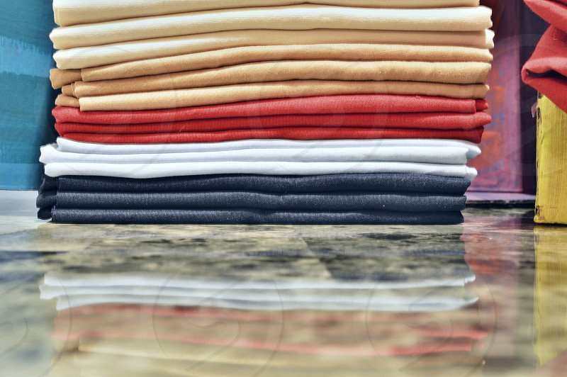 white beige red and grey filed folded textile photo