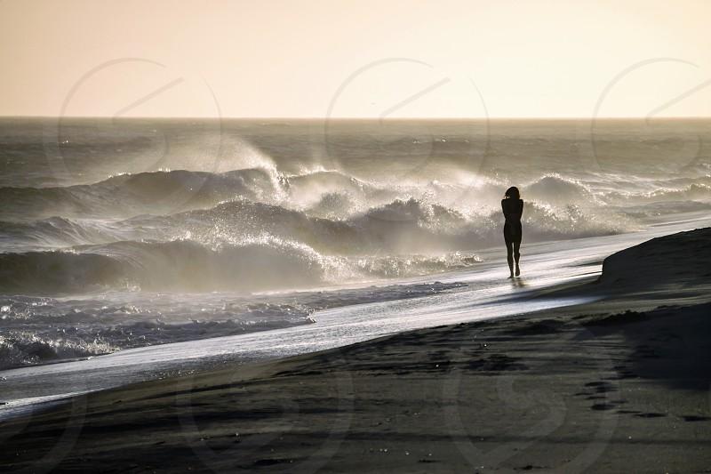 woman walking on sea side photo