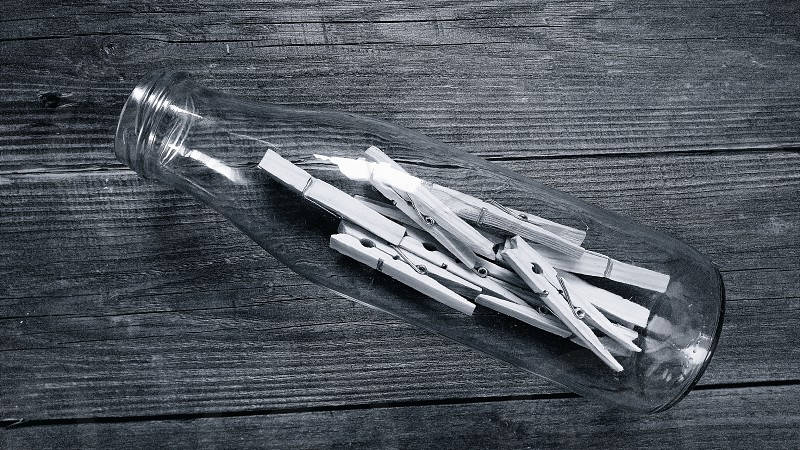 composition things wooden clothespins glass bottlewooden base photo