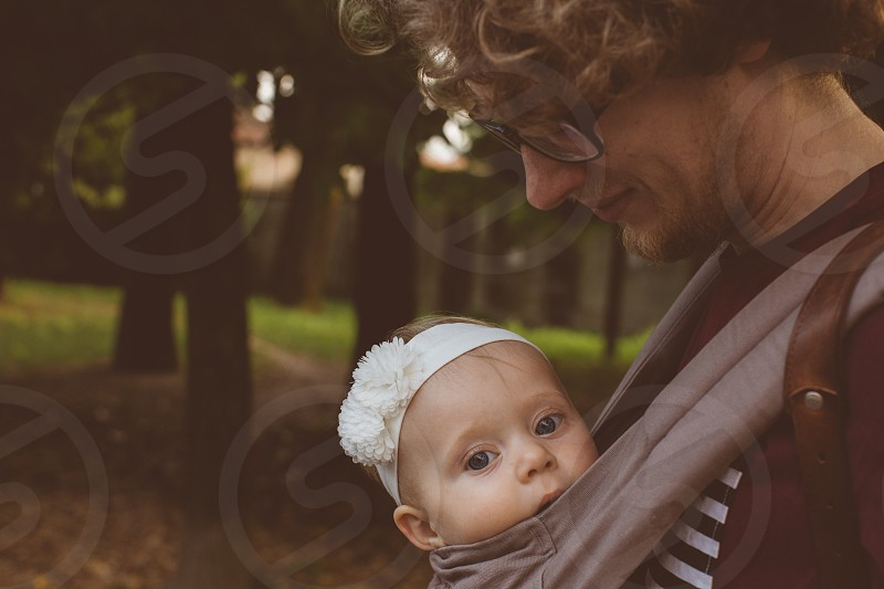 father and baby in carrier photo