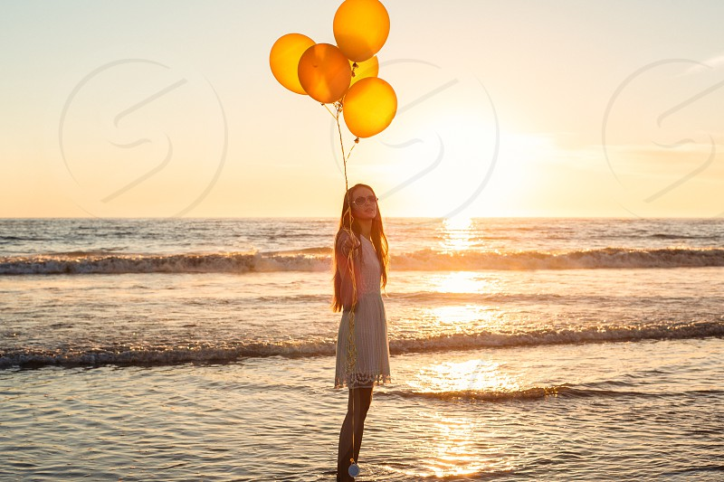 Balloons golden gold ocean beach Santa Monica Los Angeles young woman white dress beautiful photo