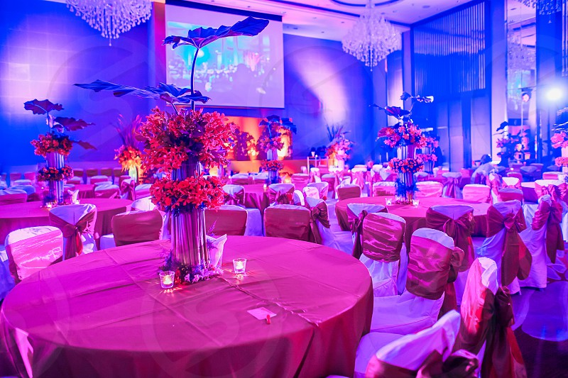 Luxury and colorful wedding reception dinner table setup with bouquet flower decoration in blue pink theme for sangeet night party of traditional indian wedding photo
