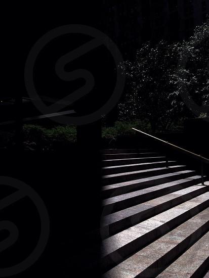 NYC city streets shadows light harsh light stairs manhattan  photo
