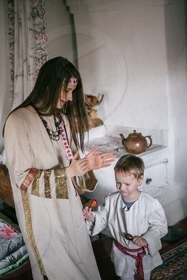 people national hair Russian woman  mama and child home  Russialove motherhood tenderness care traditions national costume Old Believers Russian dance happy cheerful photo
