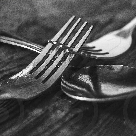 grayscale photo of spoon and fork on a macro shot photography photo