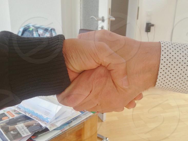 two people handshaking photo