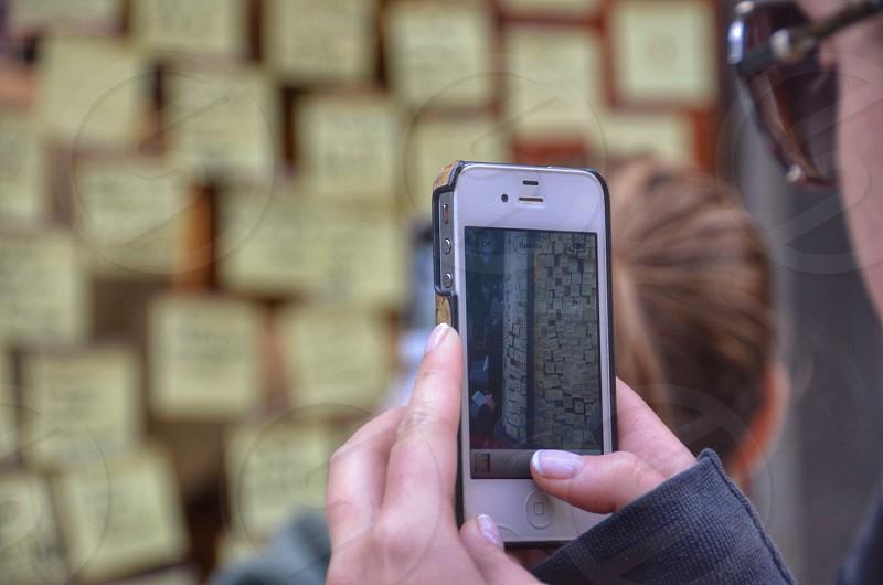 white iphone on hand photo