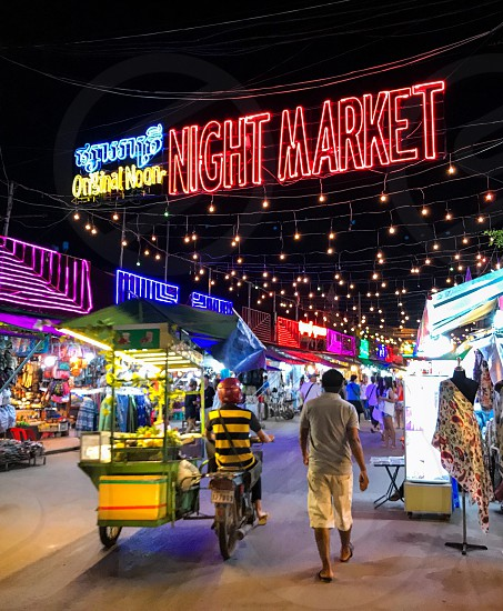 Outdoor night colour landscape horizontal Night Market Seam Reap Cambodia lights string lights fairy lights illumination glow colourful lighting stalls travel travelling tourism tourist wanderlust summer commerce trading shopping shoppers retail square photo