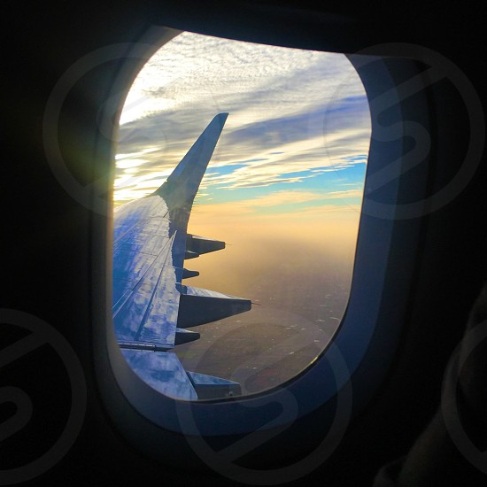 Travel airplane wing plane beauty Sky colorful sunset sunrise fly travel in air  photo