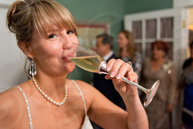 Woman drinking champagne. photo