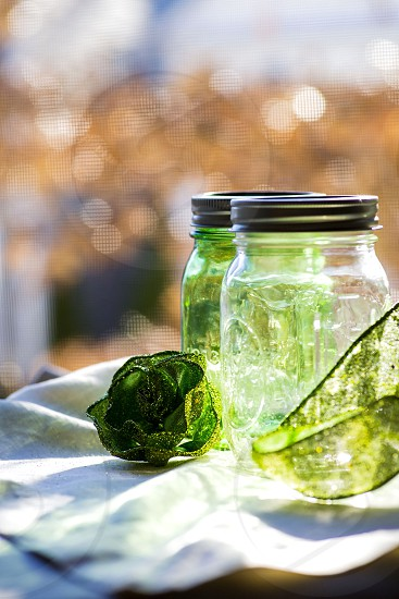 two empty glass mason jars photo