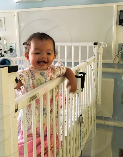 Happy baby hospital toddler baby happy toddler above all odds hospital hospital bed photo