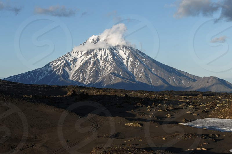 Beautiful volcanic landscape at sunset: view of the Bolshaya Udina Volcano. Klyuchevskaya Group of Volcanoes Kamchatka Peninsula Far East Russian Federation Eurasia. photo