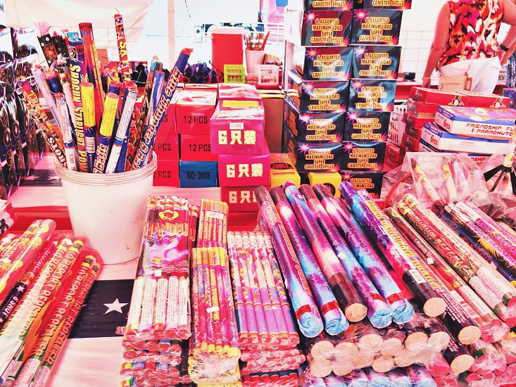 Fireworks stand fireworks on table stack of fireworks photo