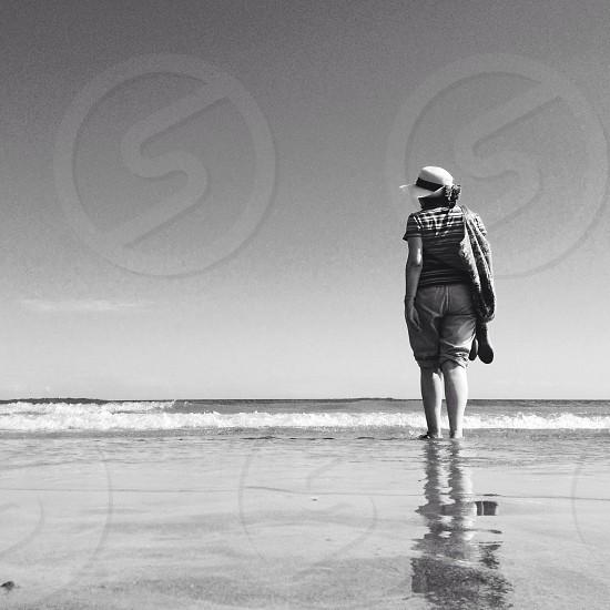 woman standing on seashore photo