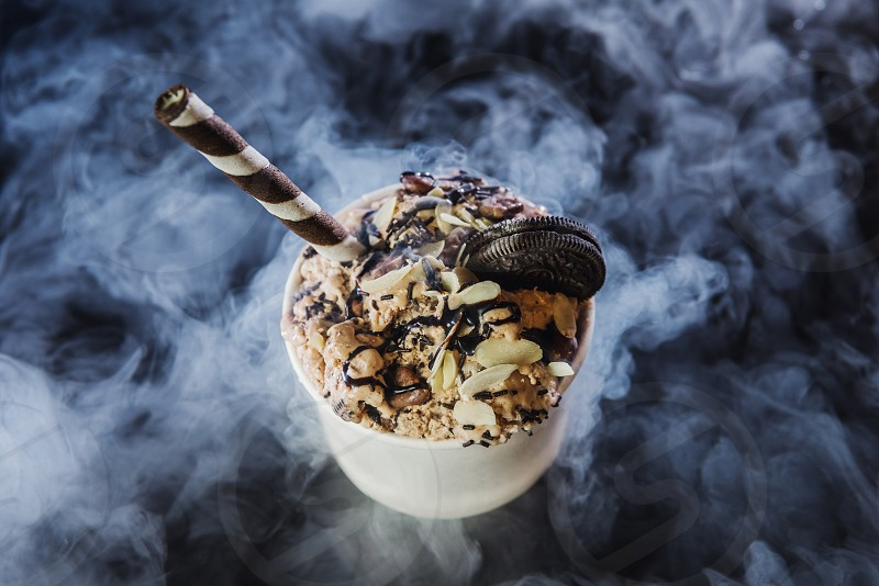 Ice cream with various sweets photo