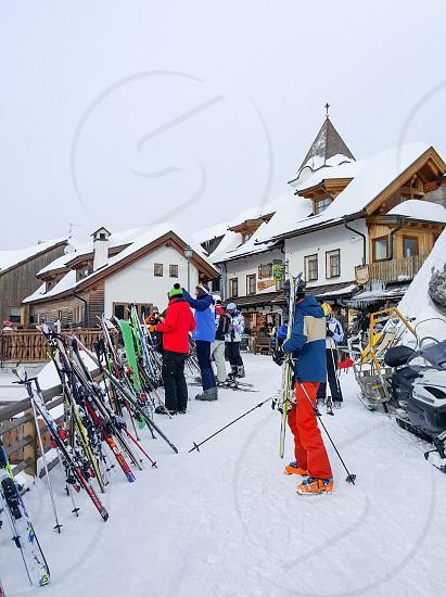 Skis and skiers at a ski resort. photo