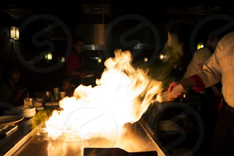 Flames from Japanese teppanyaki grill photo