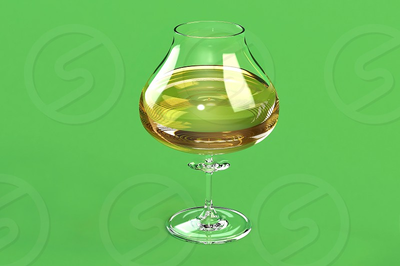 glass of wine on a green background photo