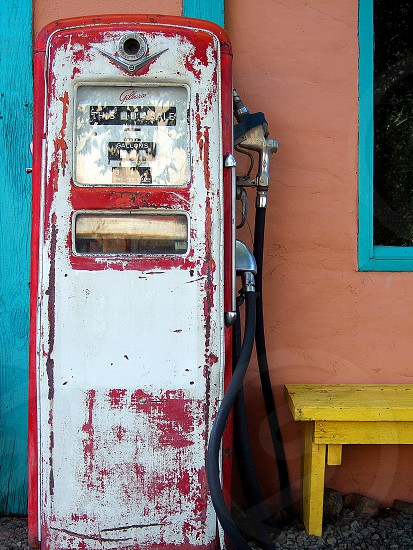 Colorful still life with painted vintage gasoline pump photo