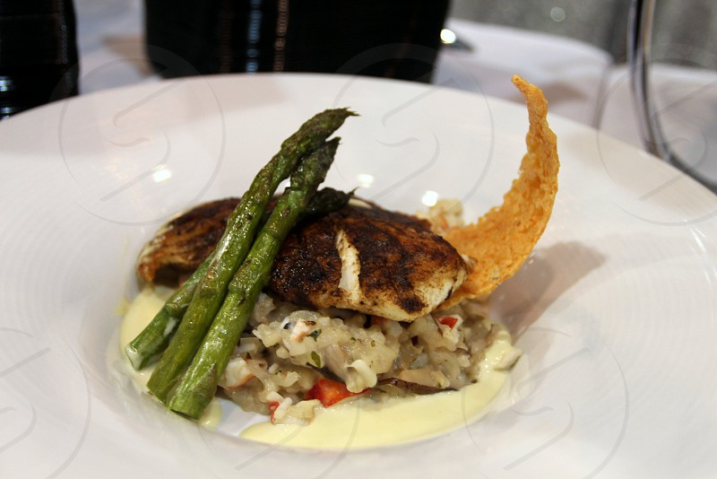 Blackened tilapia with asparagus over quinoa photo