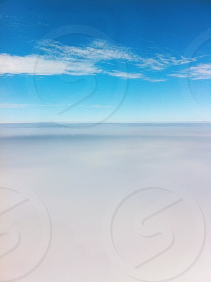 Above the world with my head in the clouds. photo