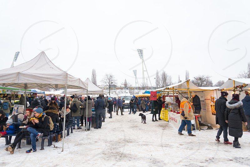 Activities of people and commodities at Mauerpark Flea market inside Prenzlauer Berg Neighborhood in Berlin Germany photo