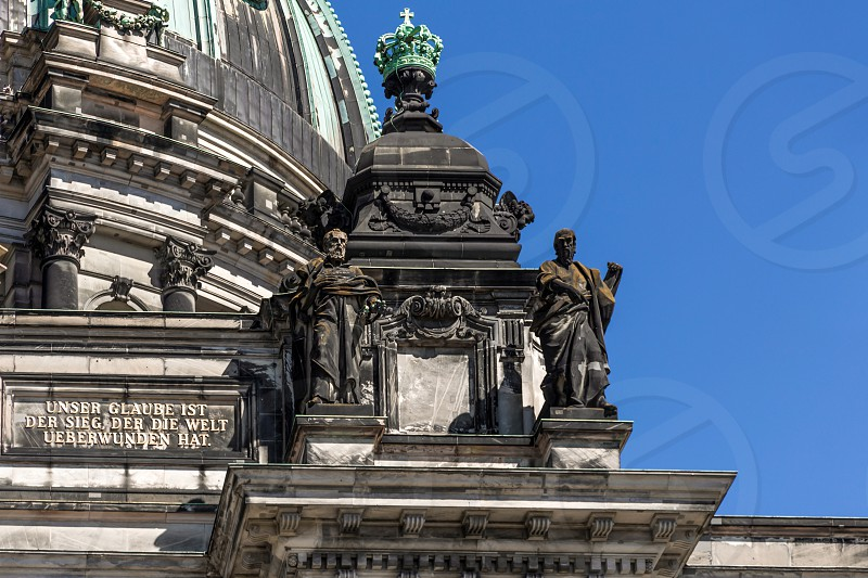 A close-up exterior view on a sculptural composition on the roof of Dom Berliner also known as the Berlin Cathedral in the historic city of Berlin in Germany. photo