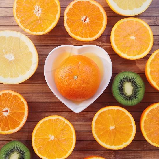 sliced orange and kiwi fruits photo