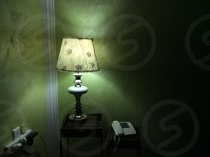 white table lamp near the wall turned on photo