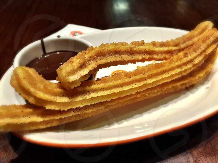 Churros chocolate sauce dessert photo