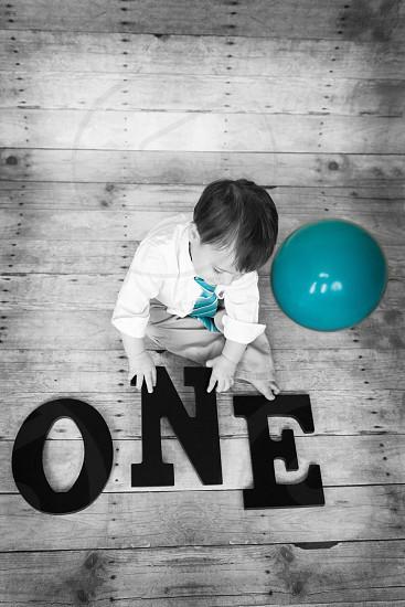 One year old baby boy boy ballon grabbing playing photo