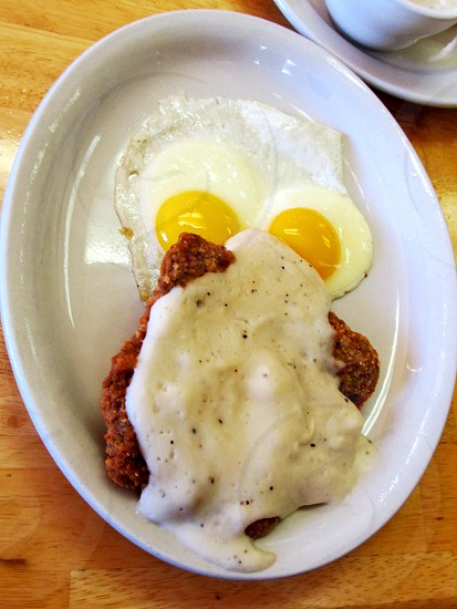 Chicken fried steak and eggs photo