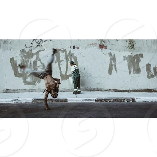 #capoeira #street #acrobat #public #street-sweeper photo