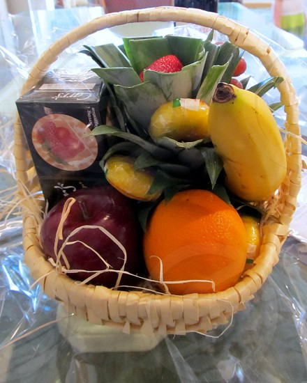 Hotel style fruit basket with banana cheese pineapple apple orange and crackers photo