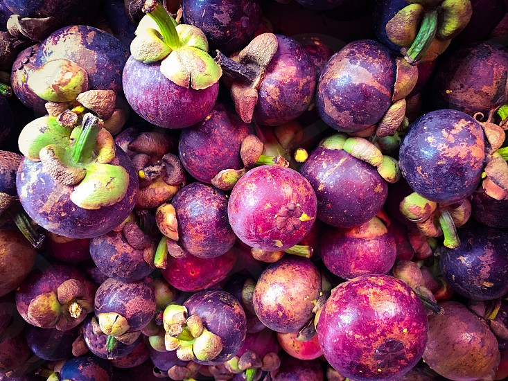 mangosteen Garcinia mangostana fruit tropical purple plant fresh healthy organic nature food sweet agriculture market mass background Thailand delicious basket sell sale green red ripe harvest photo
