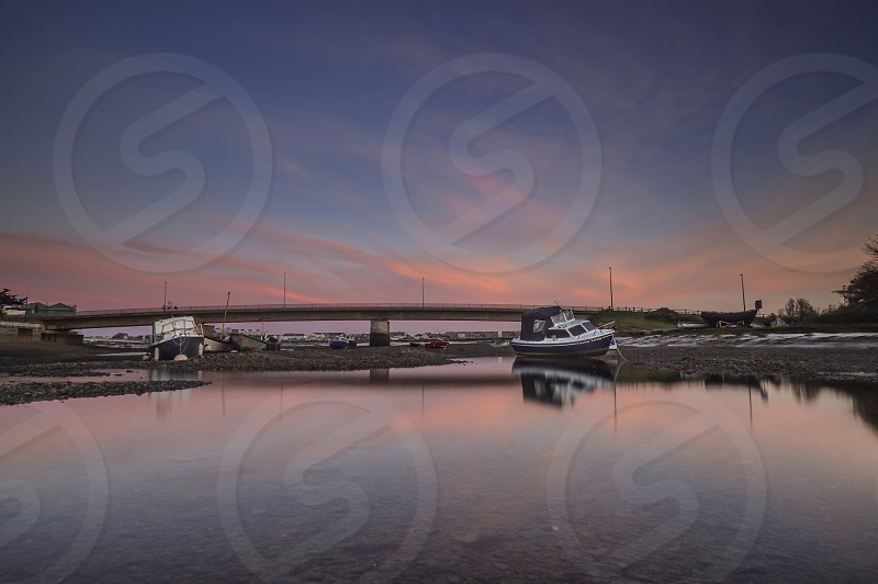Boat river sunset sky water shoreham Sussex photo