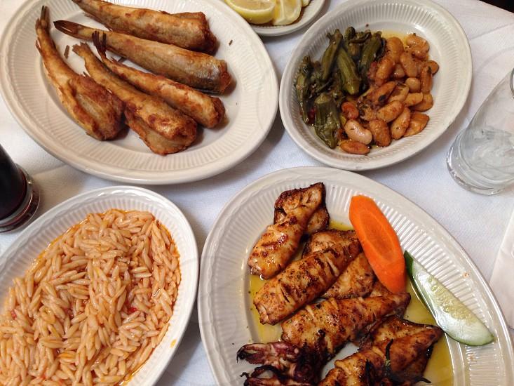 Greek food galore. Grilled calamari fried whittings.  photo